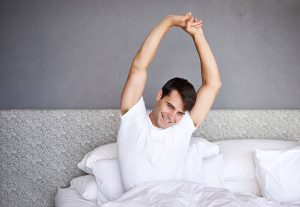 man waking up well-rested