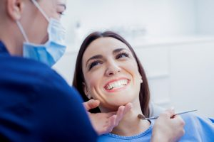 female patient smiling at hygienist