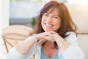 middle-aged woman smiling outdoors