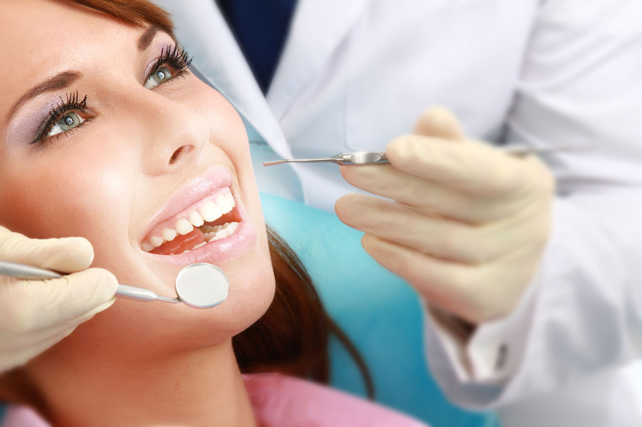 female patient getting her teeth cleaned