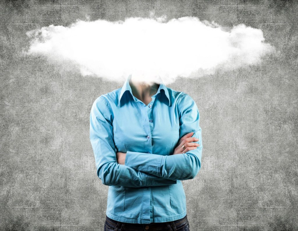 woman with a cloud of fog covering her face
