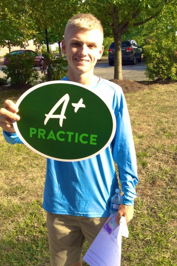 young male patient holding up green sign that says A+ Practice
